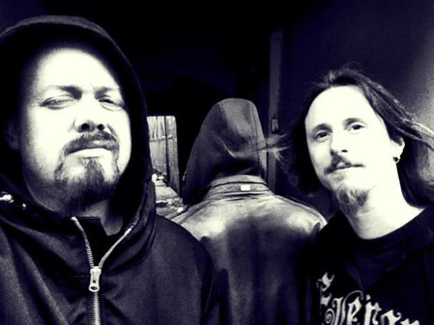 Tom, Rikard and a mysterious new member of Evergrey. Just who is the new drummer?